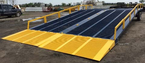 M35-161025 Adapt-A-Ramp with a 16' width, 10 level-off and 25' incline section with removable guard rails.